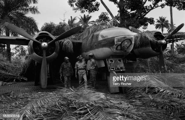 Soldiers posing in front of a captured plane during the Nigerian conflict with Biafran forces Nigeria 1968