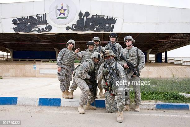 Soldiers posing outside Mahmoon Palace, originally built to celebrate Saddam HusseinÕs birthdays, Tikrit