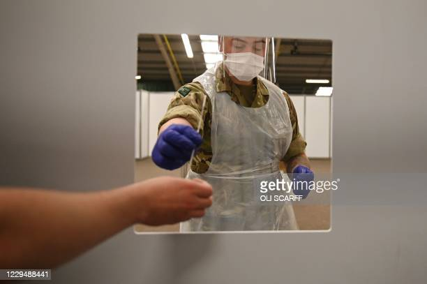 Soldiers practice administering swab tests in advance of it opening to the public at a mass and rapid testing centre for the novel coronavirus...