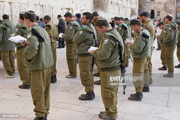 Soldiers pray at the Western Wall in Jerusalem the holiest site in Judaism situated below the Dome of the Rock Islam's second holiest site