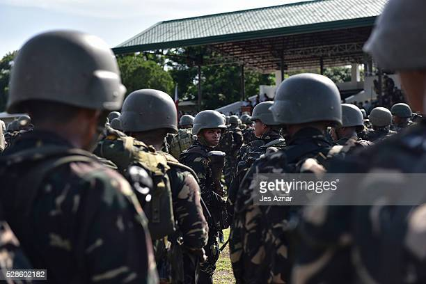 Soldiers prepare for deployment inside their camp in Datu Odin Sinsuat Maguindanao Philippines on May 5 just a few days before the country's national...
