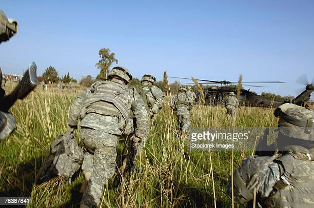 Soldiers prepare to board a UH-60 Black Hawk helicopter.