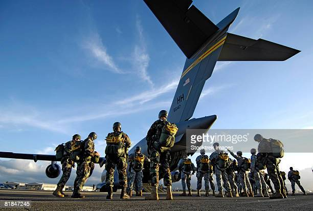soldiers preparing to board a c-17 globemaster. - air force stock pictures, royalty-free photos & images