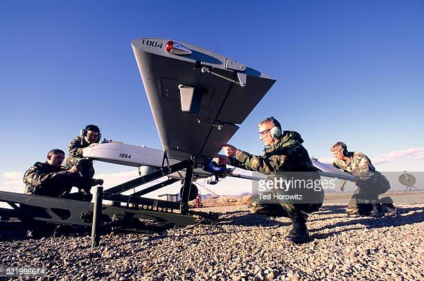 soldiers preparing unmanned aerial vehicle for launch - military drones stock pictures, royalty-free photos & images