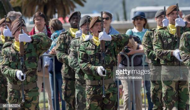 Soldiers present arms while singing the national anthem upon the arrival of Portuguese President Marcelo Rebelo de Sousa to greet the President of...