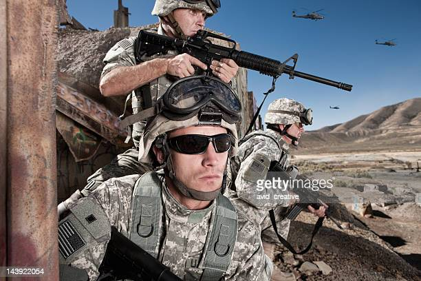 soldiers provide cover in the desert - us military stock pictures, royalty-free photos & images