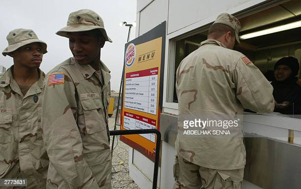 US soldiers queue for lunch at a Burger King window at the military base of Talil near Nasiriyah in southern Iraq 01 December 2003 Burger King is one...