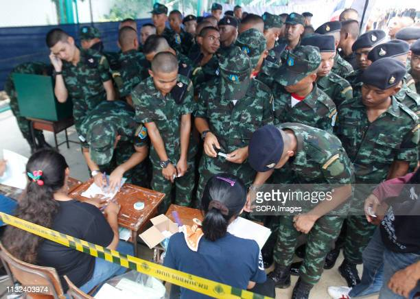 Soldiers queue up to vote during Thailand's general election in Bangkok