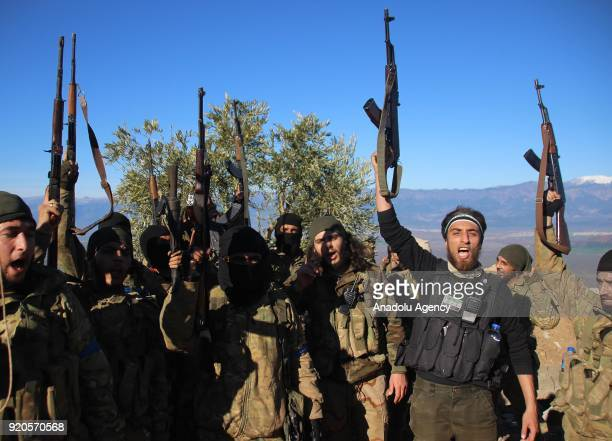 Soldiers raise their guns in the air after the Turkish military and the Free Syrian Army liberated Ikidam Shaltah Marsawiyah villages and Hill 687 in...