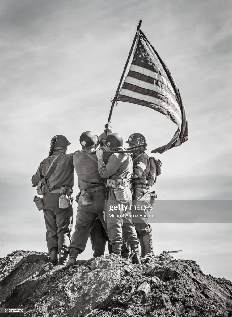 Soldiers Raising the US Flag : Stock Photo