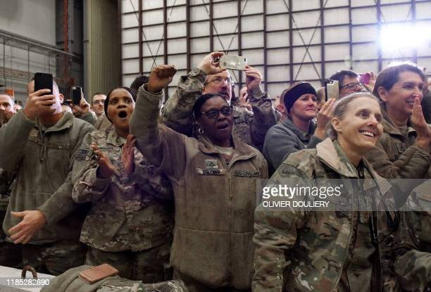US Soldiers react with cheers and applause as US President Donald Trump arrives in Bagram Air Field during a surprise Thanksgiving day visit on...