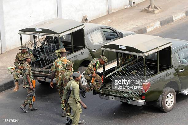 Soldiers remove metal barricade used in blocking the road by protesters as government deployed soldiers to check labour and civil societies...