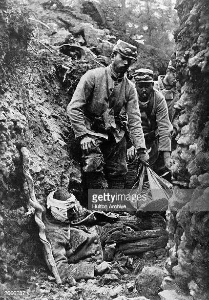 Soldiers removing corpses from a trench after fighting at Bagatelle in the Argonne Original Publication L'Illustration pub 1915