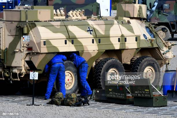 Soldiers repair a Fuchs armored command utility and infantry vehicle of the German armed forces Bundeswehr during the informative educational...