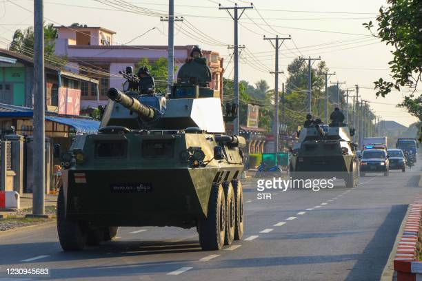 Soldiers ride in military armoured vehicles in Myitkyina, Kachin state on February 3 as Myanmar's ousted leader Aung San Suu Kyi was formally charged...