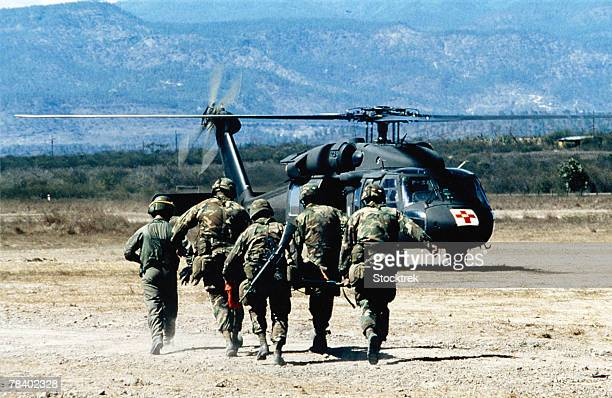 soldiers running to medical helicopter - injured u.s. army stock photos and pictures