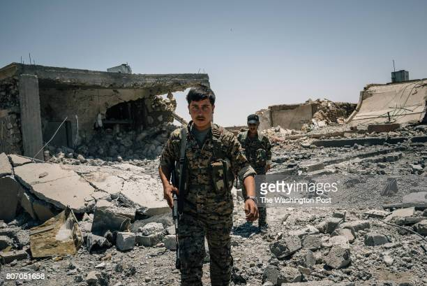 SDF soldiers rush through debris while a drone is heard above them