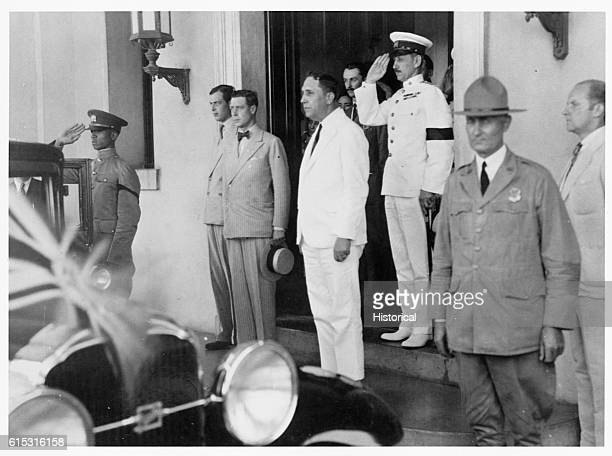 Soldiers salute as Edward Prince of Wales stands on the steps of the Administration Building In 1936 Edward would become King Edward VIII of England...