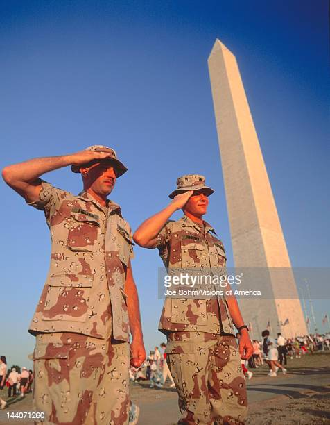 Soldiers salute at Desert Storm Victory Parade Washington DC