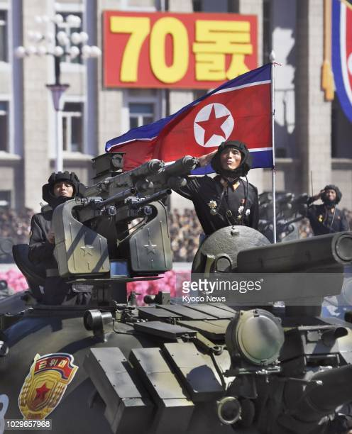Soldiers salute during a military parade at Kim Il Sung Square in Pyongyang on Sept. 9 to mark the 70th anniversary of the country's founding. ==Kyodo