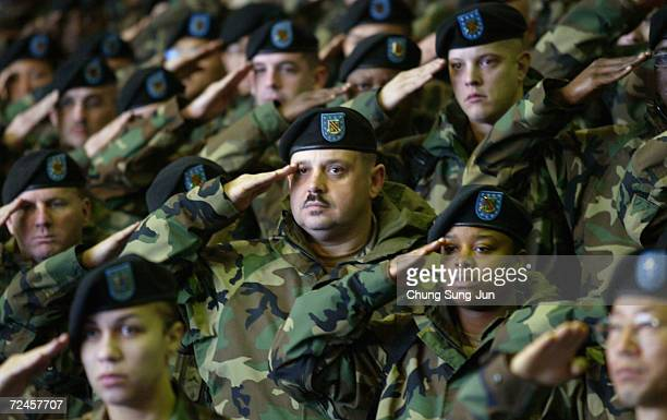 S soldiers salute during a welcome home ceremony for their colleagues who were part of a Task Force deployed from South Korea to Iraq on October 2004...
