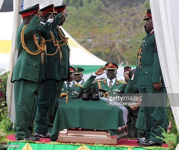 Soldiers salute Nigeria's secessionist leader Odumegwu Ojukwu during the national interdenominational funeral rites at Michael Opkara Square in Enugu...