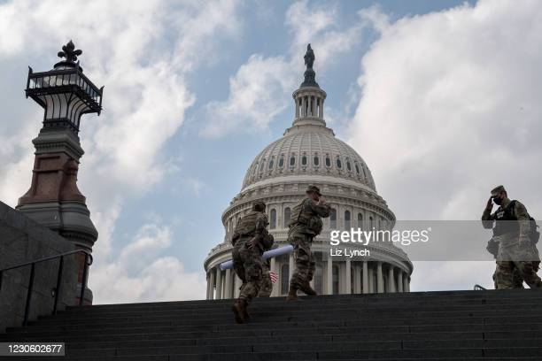 Soldiers salute one another at the US Capitol ahead of the inauguration on January 15, 2021 in Washington, DC. After last week's Capitol Riot...