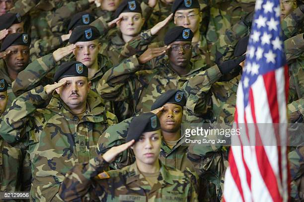 S soldiers salute the flag of the USA during a welcome home ceremony for their colleagues who were part of a Task Force deployed from South Korea to...