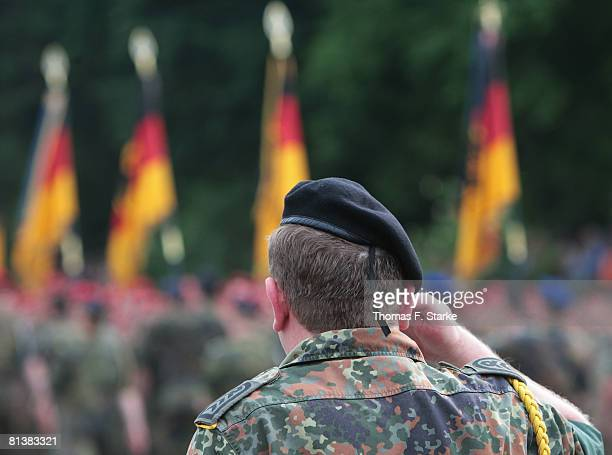 A soldiers salutes during the roll call of the 17th German ISAF contingent at the Regenstorplatz on June 3 2008 in Lemgo Germany The military...