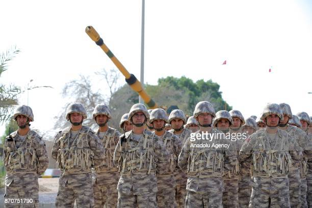 Soldiers salutes Turkish Minister of Defense Nurettin Canikli during his visit at QatariTurkish Armed Forces Land Command base in Doha Qatar on...