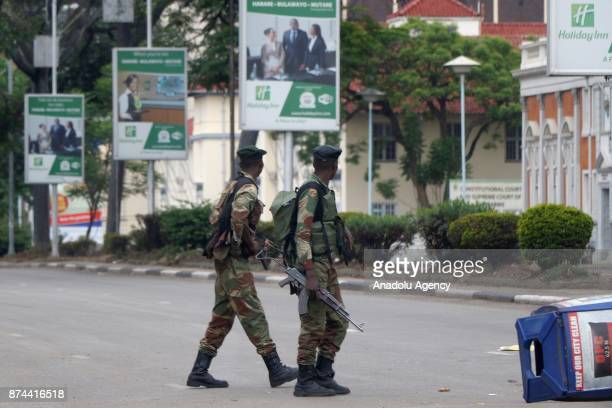Soldiers seal off a main road to the Zimbabwe high court within the military activities taking place in Harare Zimbabwe on November 15 2017 President...
