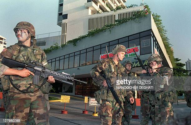 US soldiers secure a position outside the Vatican embassy in Panama City where Panamanian General Manuel Noriega is seeking asylum during Operation...