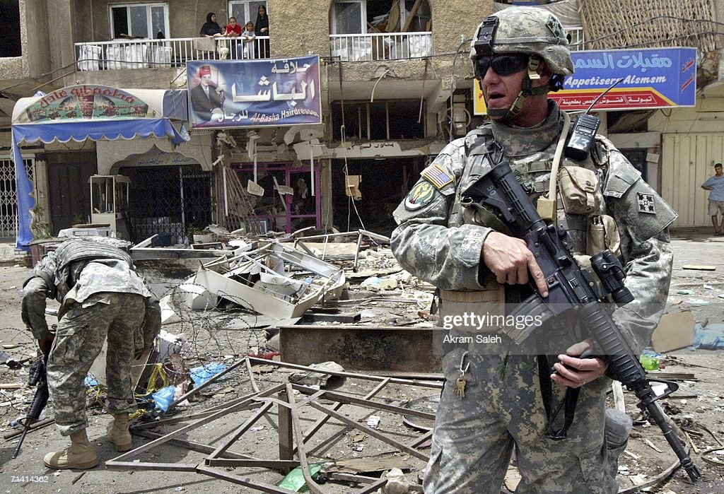 U.S soldiers secure at the site of a car bomb explosion outside the heavily fortified Green Zone area on July 11, 2006 in Baghdad, Iraq. Three people were killed and seven were wounded in the attack. ( Photo by Akram Saleh / Getty Images).