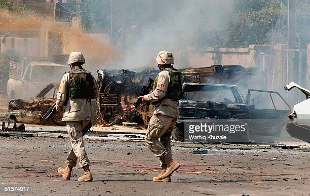 S soldiers secure the area after three explosions September 30 2004 in Baghdad Iraq Three sepereate explosions near a US military convoy which was...