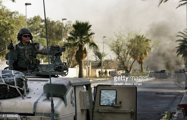 S soldiers secure the area around two wrecked humvees belonging to the 1st Marine Expeditionary Force September 22 2004 in the Mansour district of...