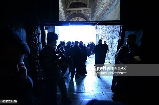 Soldiers secure the entrance of the Hagia Sophia Mosque during Pope Francis visit on November 29 2014 in Istanbul The pope held talks with Turkish...