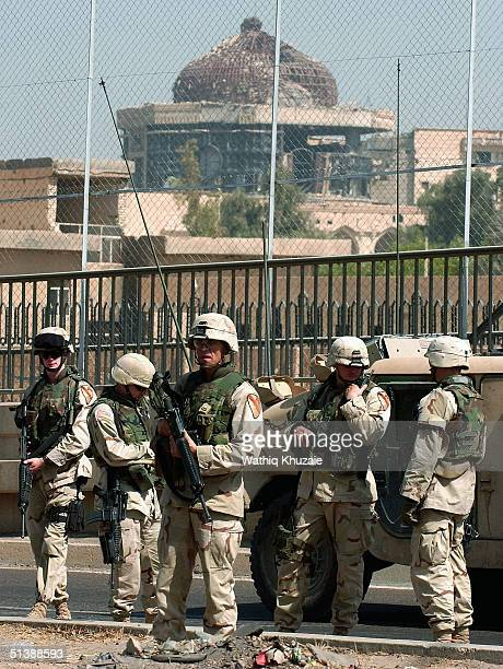 S soldiers secure the scene of a car bomb explosion October 4 2004 in Baghdad Iraq The blast occurred near an entrance of the heavily fortified Green...