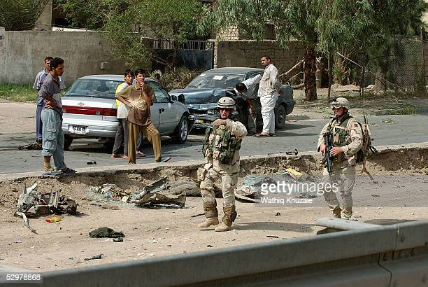 S soldiers secure the scene of a suicide car bomb explosion which failed to hit a US military convoy May 25 2005 in the area south of Baghdad Iraq...