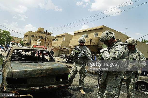 S soldiers secure the site of a car bomb explosion on May 14 2007 in Karrada Shiite neighborhood in Baghdad Iraq A car bomb exploded at a parking lot...