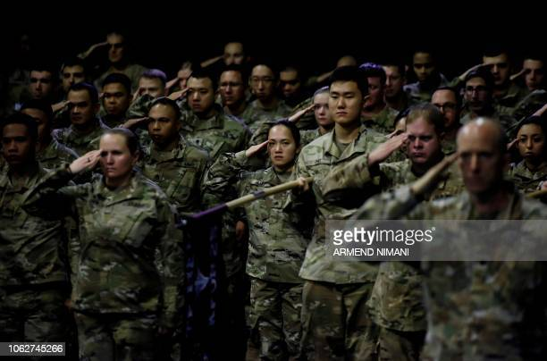 US soldiers serving in the NATO ledpeacekeeping mission in Kosovo salute as they take part in a change of command ceremony at the US military camp...