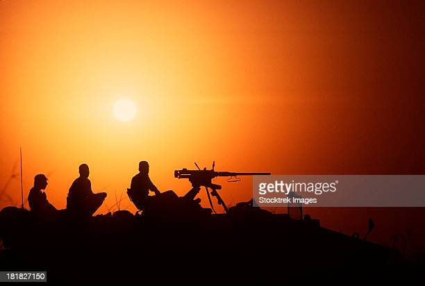 Soldiers set up security at an outpost during Operation Desert Storm.