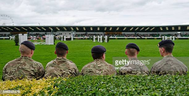 Soldiers sit in the main arena ahead of the show jumping events at the Great Yorkshire Show on July 12 2016 in Harrogate England The annual Great...