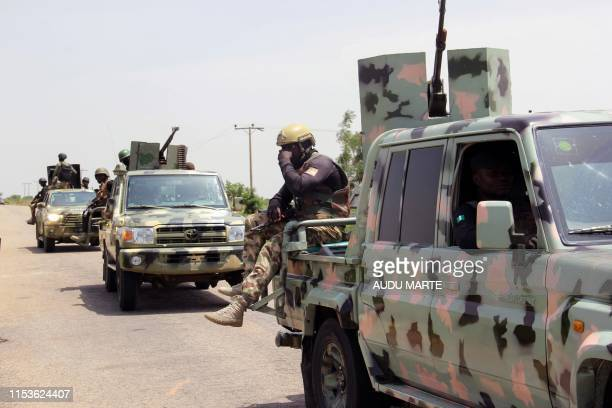 Soldiers sit in trucks as the patrol in Goniri, Yobe State, in Nigeria's restive northeast on July 3, 2019. - Boko Haram's decade-long campaign of...