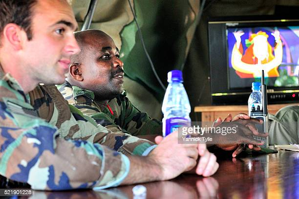 US soldiers sit together with Ugandan forces