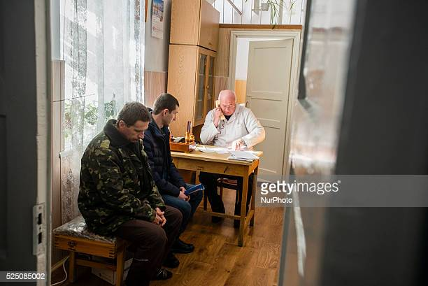 Soldiers sitting in the line in Physiotherapist ward in Military Hospital Ukraine During UkrainianRussian conflict military hospitals overloaded for...