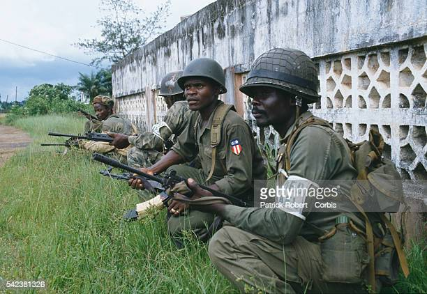 AFL soldiers squat behind a wall during the Liberian Civil War The AFL is the national army under the Samuel Doe regime By 1992 the AFL maintained...