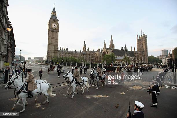 Soldiers stage a dress rehearsal of the royal carriage procession from Westminster Hall to Buckingham Palace prior to the Diamond Jubilee...
