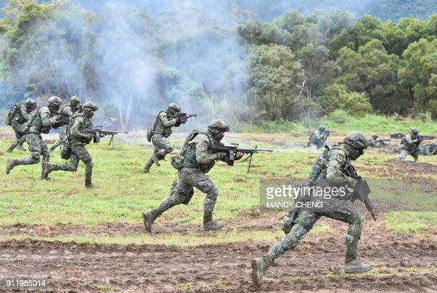 Soldiers stage an attack during an annual drill at the a military base in the eastern city of Hualien on January 30, 2018. Taiwanese troops staged...