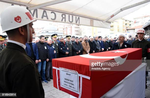 Soldiers stand at attention by the flagdraped coffin of First Lieutenant Erdem Mut who was martyred in a helicopter accident within the 'Operation...