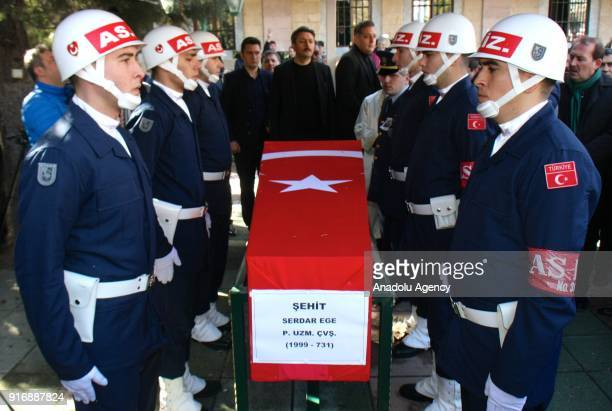Soldiers stand at attention by the flagdraped coffin of Infantry Sergeant Serdar Ege who was martyred within the Operation Olive Branch in Syria's...